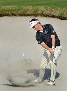 Spencer Levin hits out of the bunker on the first hole during the third round of the Northern Trust Open. Pacific Palisades, CA 2/18/2012(John McCoy/Staff Photographer)