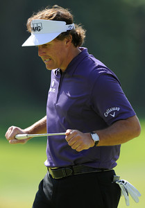 Phil Mickelson reacts to missing a birdie put on the 8th green, after making a scramble from the rough and a flower garden next to a sponsors tent during the third round of the Northern Trust Open. Pacific Palisades, CA 2/18/2012(John McCoy/Staff Photographer)