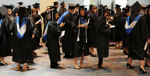 Graduates wait for  commencement ceremonies to begin Tuesday, June 7, 2011at Mission College in Sylmar, Ca.  (Hans Gutknecht/Staff Photographer)