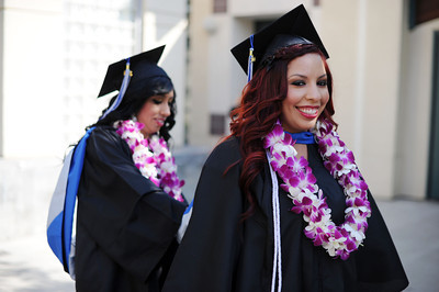 Linda Leon, 24-years-old, helps Daisy Ramos, 22-years-old, get ready before commencement ceremonies Tuesday, June 7, 2011at Mission College in Sylmar, Ca.  (Hans Gutknecht/Staff Photographer)