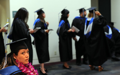 Graduate Myriam Trujillo, 32-years-old, waits to take part in commencement ceremonies Tuesday, June 7, 2011at Mission College in Sylmar, Ca.  (Hans Gutknecht/Staff Photographer)