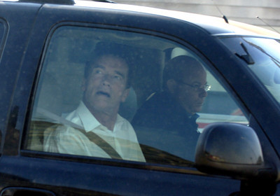 Governor Arnold looks out the window of his car on PCH in Malibu, Ca., while watching firefighters put down a fire next to a fire station on Monday, Oct.22, 2007.  (Tina Burch/Staff PHotographer)