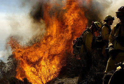 Brush along Rambla Pacifico Road in Malibu flares up while California Department of Forestry firemen work the fire on Monday, Oct. 22, 2007 in Malibu, Ca.  (Tina Burch/Staff Photographer)