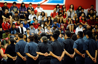 Monroe HS students in the police and fire academies stand in attention as they honor the fallen heroes of 9/11. They were joined by classmates as  poems written by students were read aloud. There was a moment of silence and a time of reflection as students commemorate the tragic events of 9/11. Sept 9,2011. North Hills CA. Photo by Gene Blevins/LA DailyNews