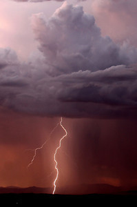 Lightning strikes across the skies as the National Weather Service has issued a storm and flash-flood warning for the Antelope Valley, with the possibility of heavy rain, strong winds and hail. In addition, a flash-flood warning was issued for Lancaster,