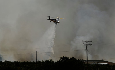 Lightning strikes from monsoon storms sparked several brush fires across Southern California on Saturday, the largest was in Pinon Hills where 150 acres burned.   Los Angeles County and San Bernardino fire department battle the brush fires near Fort Tejon Road and Highway 138 in San Bernardino County were no structures were lost.  Aug 27,2011 photo by Gene Blevins/LA DailyNews