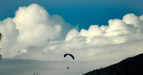 A paraglider flies through the air as monsoon rain cells make their way over the south land areas in the late afternoon in Lake View Terrace. July 10,2010.  Photo by Gene Blevins/LA Daily News