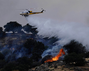 Helicopters make water drops  on several brush fires were started by lightning strikes along highway 58 from monsoon storms passing through the southland areas of Keen CA. in the Kern county area. CA. Sept 10,2011.  Photo by Gene Blevins/LA DailyNews