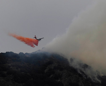 A air tanker makes a drop  on several brush fires were started by lightning strikes along highway 58 from monsoon storms passing through the southland areas of Keen CA. in the Kern county area. CA. Sept 10,2011.  Photo by Gene Blevins/LA DailyNews