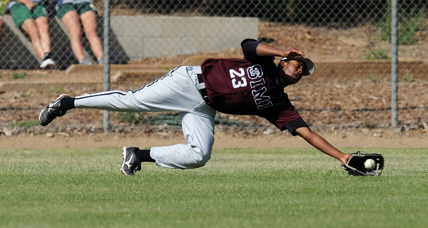 Simi Valley's Mykel Davis makes a diving catch on deep Moorpark's Matt Corcoran fly ball but can't hold on to it allowing a run to score in the 3rd inning  during their game at Moorpark High School Friday, May 6, 2011. (Hans Gutknecht/Staff Photographer)