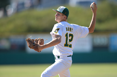 Moorpark's Sean Barry delivers a pitch against Agoura High School April 17, 2013 in Moorpark, CA.(Andy Holzman/Staff Photographer)