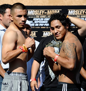 (L-R) Franike Gomez weighed in at 143 pounds as he poses with Ricardo Calzada who weighed in at 143 pounds, as the fight will be live on HBO-PPV Saturday night at Staples Center in Los Angeles CA.  Sept 17,2010. Photo by Gene Blevins/LA Daily News