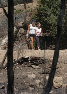 Laura Meraz, 29, and Maria Estrada, 29, hike by the burned area on the Mount Hollywood Trail in Griffith Park on Monday, August 27, 2007, in Los Angeles.  (Tina Burch/Staff Photographer)
