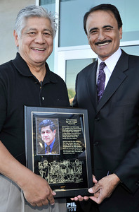 Muralist Ignacio Gomez is presented with a plaque by LA City Councilman Richard Alarcon. The newly constructed and opened Northeast Valley Neighborhood City Hall located at 13520 Van Nuys Blvd, celebrated the unveiling of a Mural commemorating the diversity of leaders who have emerged from the Northeast Valley community.  These include writers, sports figures, artists, musicians, community leaders and non-profit organizers. The specially commissioned mural was painted by Los Angeles artist Ignacio Gomez. Pacoima, Ca 7-26-2011. (John McCoy/Staff Photographer)