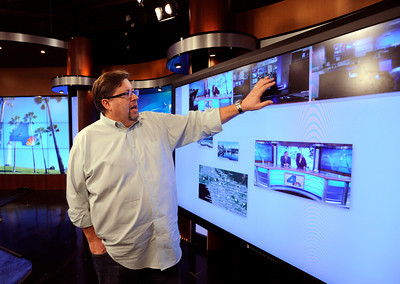 """Richard Westcott demonstrates how a new """"Perceptive Pixel"""" monitor can be used on live television to help tell the story. The 82 inch Hi-tech touch screen can even use Google Earth to show the locations of breaking news stories. NBC4 Los Angeles is undergoing a multi million dollar makeover that includes a new set for the news, more employees, and new logo and upgraded equipment. Burbank, CA 1/20/2012(John McCoy/Staff Photographer)"""