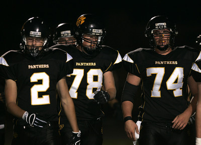 Newbury  Park players, from left, Danny Diefenthaler, Ashton Wood and Tm Ketaily was onton the field before the game against Westlake on Friday, Oct. 5, 2007. (Edna T. Simpson)
