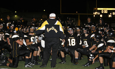 Newbury Park's Coach George Hurley talks with his players after winning the game against Westlake on Friday, Oct. 5, 2007.  Newbury Park won 27-13 (Edna T. Simpson)