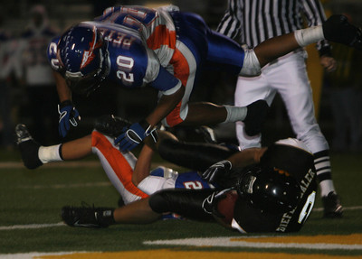 Westlake's Curtis Peterson dives over Newbury Park's Danny Diefenthaler during the game on Friday, Oct. 5, 2007 at Newbury Park. (Edna T. Simpson)