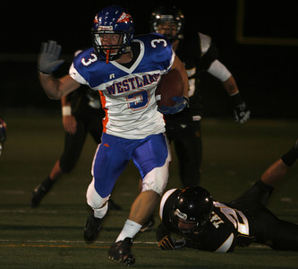 Westlake's  Cooper Shockley puts his hands up as he gains yardage during the game on Friday, Oct. 5, 2007 against Newbury Park Panthers. (Edna T. Simpson)