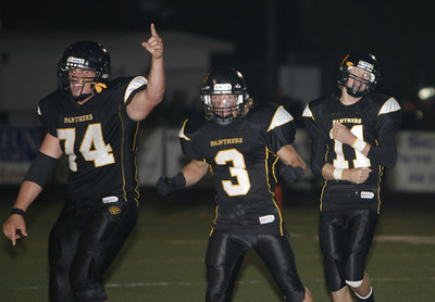 Newbury Park's Tim Ketaily, Vincent Muscarella and Colby Cameron celebrates after winning  the game against Westlake High School 27-13 on Friday, Oct. 5, 2007 (Edna T. Simpson)