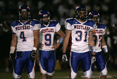 Westlake's players (L-R) Tommy Doupe, Nick Occhipinti, Garrett Cook and Lukas Freeman looks to the coach on  sideline for instructions on the next play during the game on Friday, Oct. 5, 2007 against Newbury Park Panthers. (Edna T. Simpson)