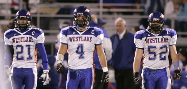 Westlake's captains of the team, left to right, #21 Kyle Wood,  Tommy Doupe and  Brian Ranieri walks onto the field at the beginning of the game on Friday, Oct. 5, 2007 against Newbury Park. (Edna T. Simpson)