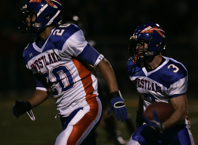 Westlake's Cooper Shockley gains yardage as he runs behind his teammate Curtis Peterson during the game on Friday, Oct. 5, 2007 against Newbury Park Panthers. (Edna T. Simpson)
