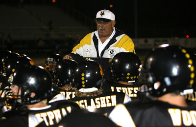 Newbury Park's Coach George Hurley congratulates his players for a great win after winning the game against Westlake 27-13 on Friday, Oct. 5, 2007 (Edna T. Simpson)
