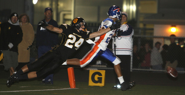 Newbury Park's Sean Bayer stretches to recover the ball that was intended for Westlake's  Curtis Peterson during the game on Friday, Oct. 5, 2007 at Newbury Park High School.  (Edna T. Simpson)