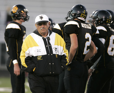 Newbury Park High School Head Coach George Hurley talks with his players doing pregame warmups against West Lake High School on Friday, Oct. 5, 2007 at Newbury Park High School.  Newbury Park won 27-13 (Edna T. Simpson)