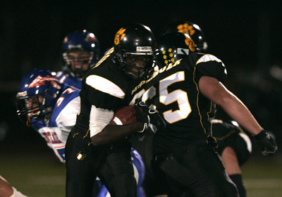Newbury Park's Chris Brown breaks away from WestLake defense during the first half of the victory game on Friday, Oct. 5, 2007. Newbury Park won 27-13 (Edna T. Simpson)