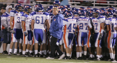 Westlake's Head Coach Jim Benkert looks across the field as his players huddle and get ready for the  first quarter against Newbury Park  Panthers. (Edna T. Simpson)
