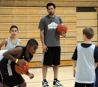 Former Los Angeles Laker and New Jersey Nets guard Jordan Farmar works kids during his fourth annual Hoop Farm Basketball Camp at UCLAÕs John Wooden Center. (Hans Gutknecht/Staff Photographer)