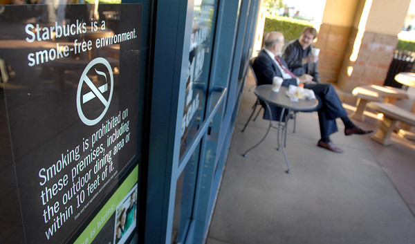 Customers enjoy a smoke free patio at the Porter Ranch Starbucks. Councilmen Greig Smith and Tom LaBonge  joined representatives of Starbucks Coffee, Coalition for a Tobacco Free L.A. County and the California Restaurant Association to discuss education and outreach in anticipation of the March 8 enforcement date of a city ordinance banning smoking on outdoor eating areas in Los Angeles, such as restaurant patios. Starbucks, 19759 Rinaldi St. (Dean Musgrove/Staff Photographer)