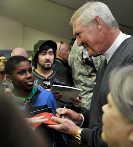 Jerry West signs autographs at the Military Outpost on the 10th fairway during the third round of the Northern Trust Open at Riviera Country Club in Pacific Palisades , CA. 2-19-2011. (John McCoy/staff photographer)