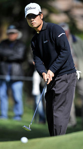 Kevin Na watches his put roll up over a knowl before heading to the cup. He would need one more put to make a birdie on the hole during the third round of the Northern Trust Open at Riviera Country Club in Pacific Palisades , CA. 2-19-2011. (John McCoy/staff photographer)