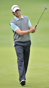 Aaron Baddeley adds a little body english to his put on the 13th green during the third round of the Northern Trust Open at Riviera Country Club in Pacific Palisades , CA. 2-19-2011. (John McCoy/staff photographer)