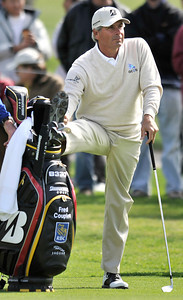 Fred Couples stretches and tries to stay loose before hitting an iron on the 2nd fairway during the third round of the Northern Trust Open at Riviera Country Club in Pacific Palisades , CA. 2-19-2011. (John McCoy/staff photographer)