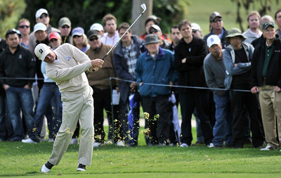 The gallery watches while Fred Couples clips some grass with his approach shot on #2 during the third round of the Northern Trust Open at Riviera Country Club in Pacific Palisades , CA. 2-19-2011. (John McCoy/staff photographer)
