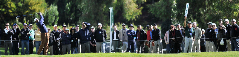 The gallery watches while Vijay Singh hits from the 2nd tee box during the third round of the Northern Trust Open at Riviera Country Club in Pacific Palisades , CA. 2-19-2011. (John McCoy/staff photographer)