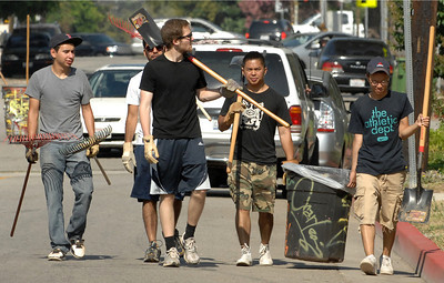 A group of young men walk down Rayen Street after clearing trash and weeds. Northridge Community Neighborhood Watch took to the streets to paint curbs and clean up trash near the corner of Rathburn and Rayen streets in Northridge. Northridge, Ca 7-30-2011. (John McCoy/Staff Photographer)