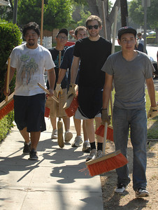 Northridge Community Neighborhood Watch took to the streets to paint curbs and clean up trash near the corner of Rathburn and Rayen streets in Northridge. Northridge, Ca 7-30-2011. (John McCoy/Staff Photographer)