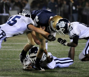 Norte Dame's QB Matt Lathuras gets hit from both sides as they take on  Loyola High during Friday night football. Oct 15,2010. Photo by Gene Blevins/LA Daily News