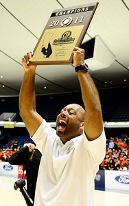 Oaks Christians coach Andre Chevalier holds the trophy as they take the win over Buckley for the Southern Section Div. IV-A boys' basketball CIF final. Anaheim CA. March 5,2011. Photo by Gene Blevins/LA Daily News