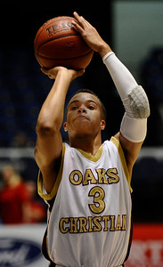 Oaks Christians #3 Chass Bryan makes a shot as they take the win over Buckley 66 to 48 for the Southern Section Div. IV-A boys' basketball CIF final. Anaheim CA. March 5,2011. Photo by Gene Blevins/LA Daily News
