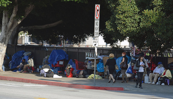 Occupy Los Angles members wait along N. Spring Street near Our Lady of Angeles Church Wednesday, November 30, 2011. (Hans Gutknecht/Staff Photographer)