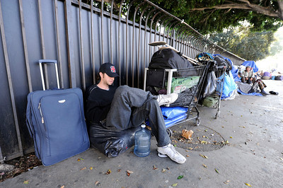 Occupy Los Angles member Jacob Smith, 33-years-old, waits along N. Spring Street near Our Lady of Angeles Church Wednesday, November 30, 2011. (Hans Gutknecht/Staff Photographer)