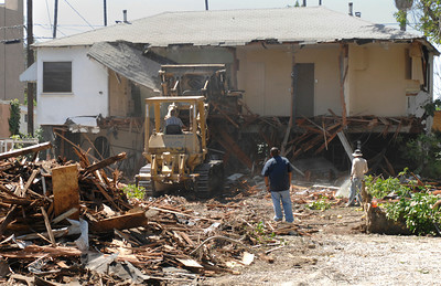 Demolition crews clear the property at 14628 Sylvan Street in Van Nuys. The original house on the lot was a craftsman style home build in 1911, and considered to be one of the oldest homes in the San Fernando Valley. A two story apartment building on the back of the lot was also demolished. Photos in Van Nuys California 6-20-2007.  photo by John McCoy/LA Daily News
