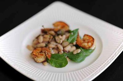 Ombra Ristorante's INSALATA DI FAGIOLI - Tuscan white bean salad, red onion, caper berries, jumbo white shrimp. (Hans Gutknecht/Staff Photographer)