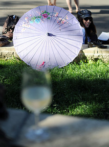 Donna Gale, Pasadena, uses an umbrella while picnicking  during Opening Night at the Hollywood Bowl, Friday, June 17, 2011 in Hollywood, Ca. (Hans Gutknecht/Staff Photographer)